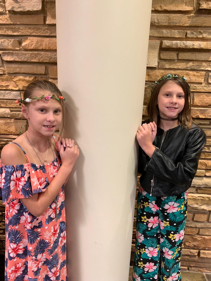 The twins were sporting their new head wreaths at church.