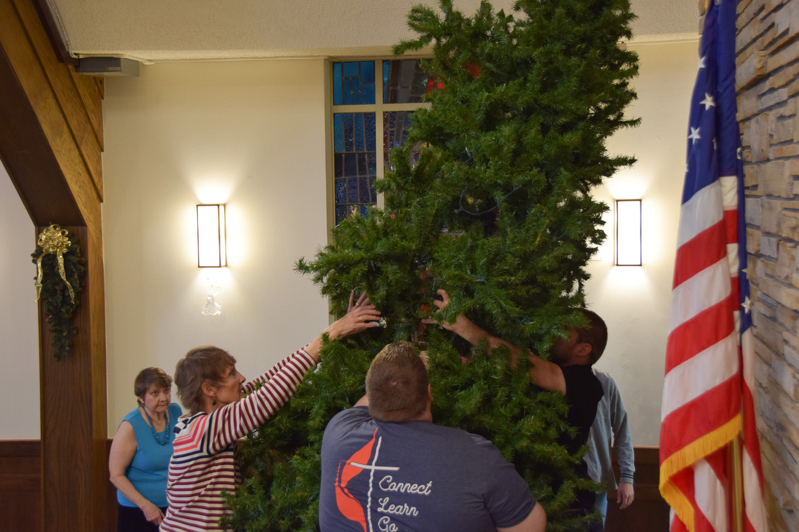 Topping off the tree.