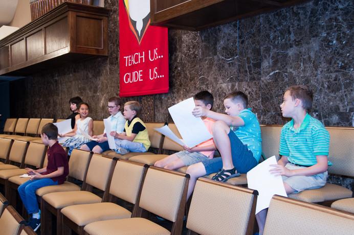 Up in the choir loft going through their lists.