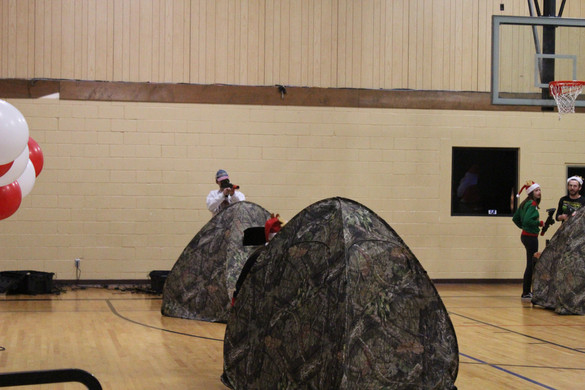 Camping in the gym. Cool tents.