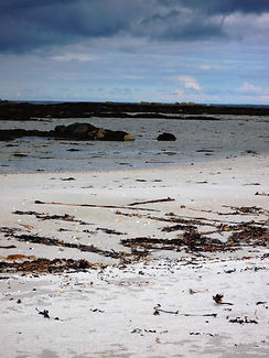 Balivanich beach photograph Benbecula beach Outer Hebrides beach seaweed on sandy beach photograph Outer hebrides coastline Scottish Isles