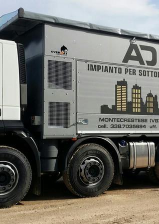 Camion autolivellante