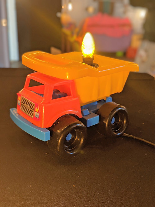 Yellow dump truck with yellow LED bulb