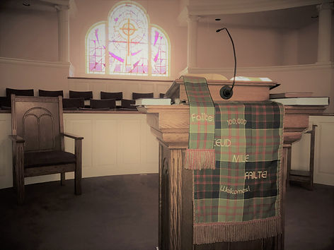The pulpit in he sanctuary of the church displays the tartan assigned to Barbecue that is displayed during homecoming.