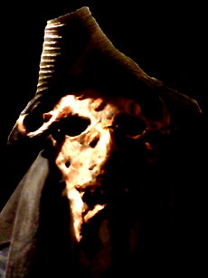A demonic figure in a tricorn hat