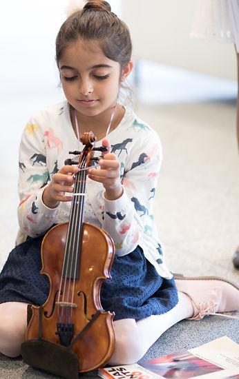 Violin Student Sitting on Floor
