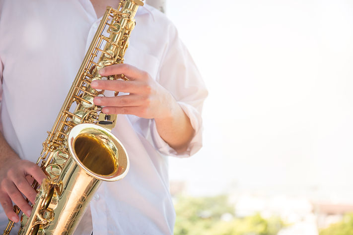 A person playing saxophone
