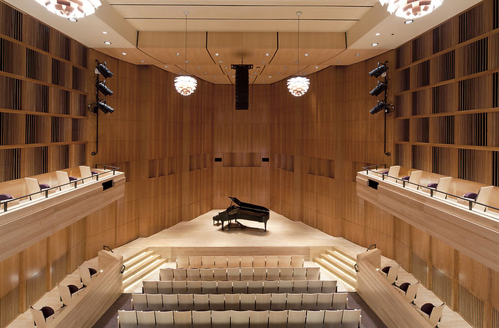 A piano in the middle of a concert hall
