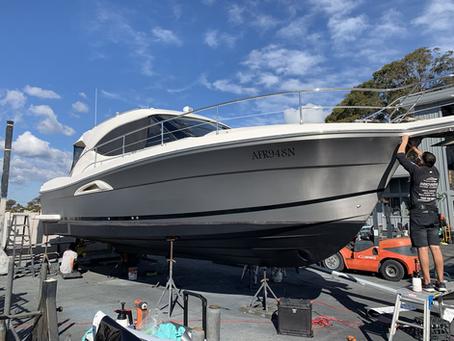 Vinyl boat wrap - Hull of Riviera 3600 in Brushed Titanium