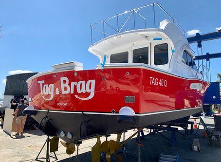 Brand new Caribbean 40 gets a hull wrap and fish decals