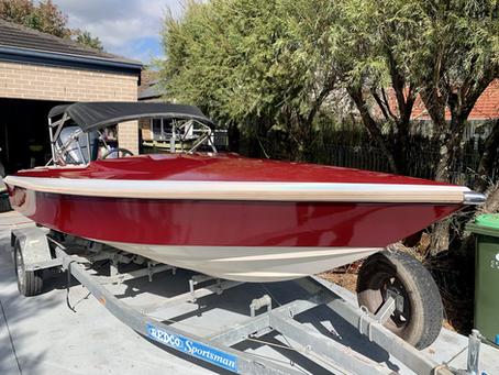 Wrap of 17ft ski boat in red