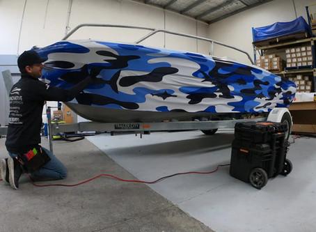 Video of vinyl hull wrap of aluminium training boat for Yamaha Australia