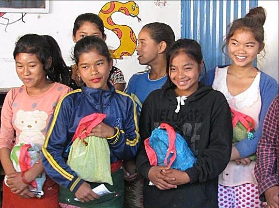 Women and girls in Nepal organising Freedom Kit Bags