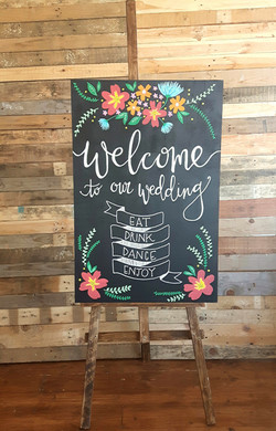 'Welcome' sign and easel