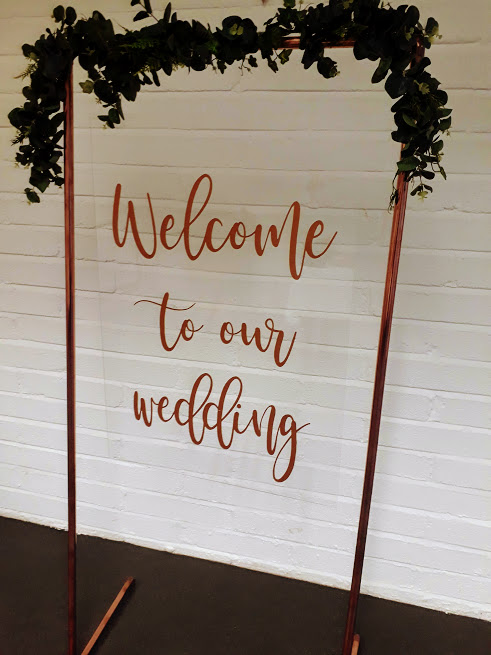 Copper welcome sign with garland