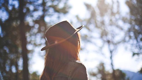 Girl in Fedora Staring at the Sun Christian Stock Photo.jpg