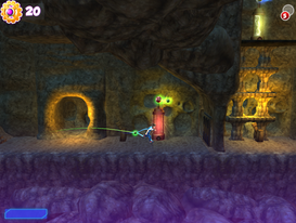 The character is in Cappadocia's underground tunnels, solving physics and action puzzles at the adventure layer of the game.