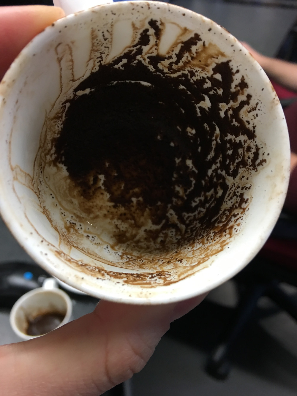 Patterns inside the coffee cup of a classmate
