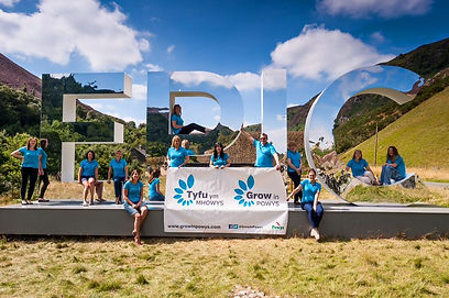 The regeneration team at the Elan Valley standing by the Epic sign