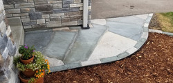 Flagstone front walk with natural stone edging