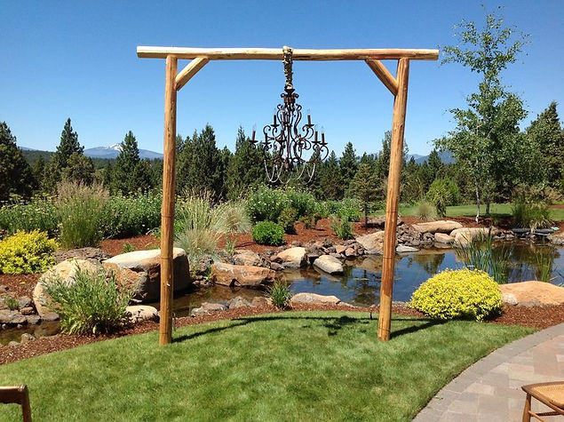 Ranch style arch with large chandelier.J