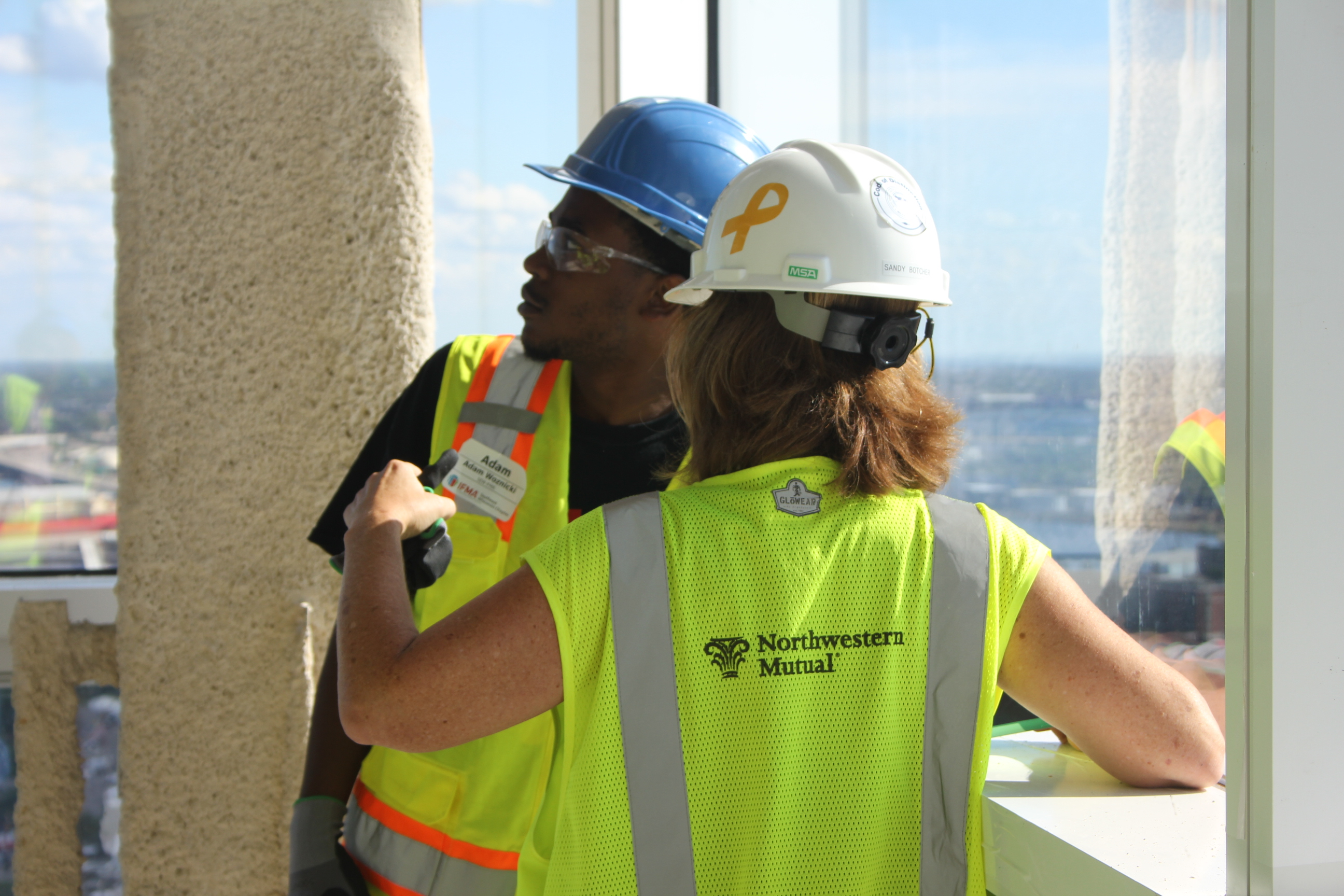 Workers interacting at NM Tower.
