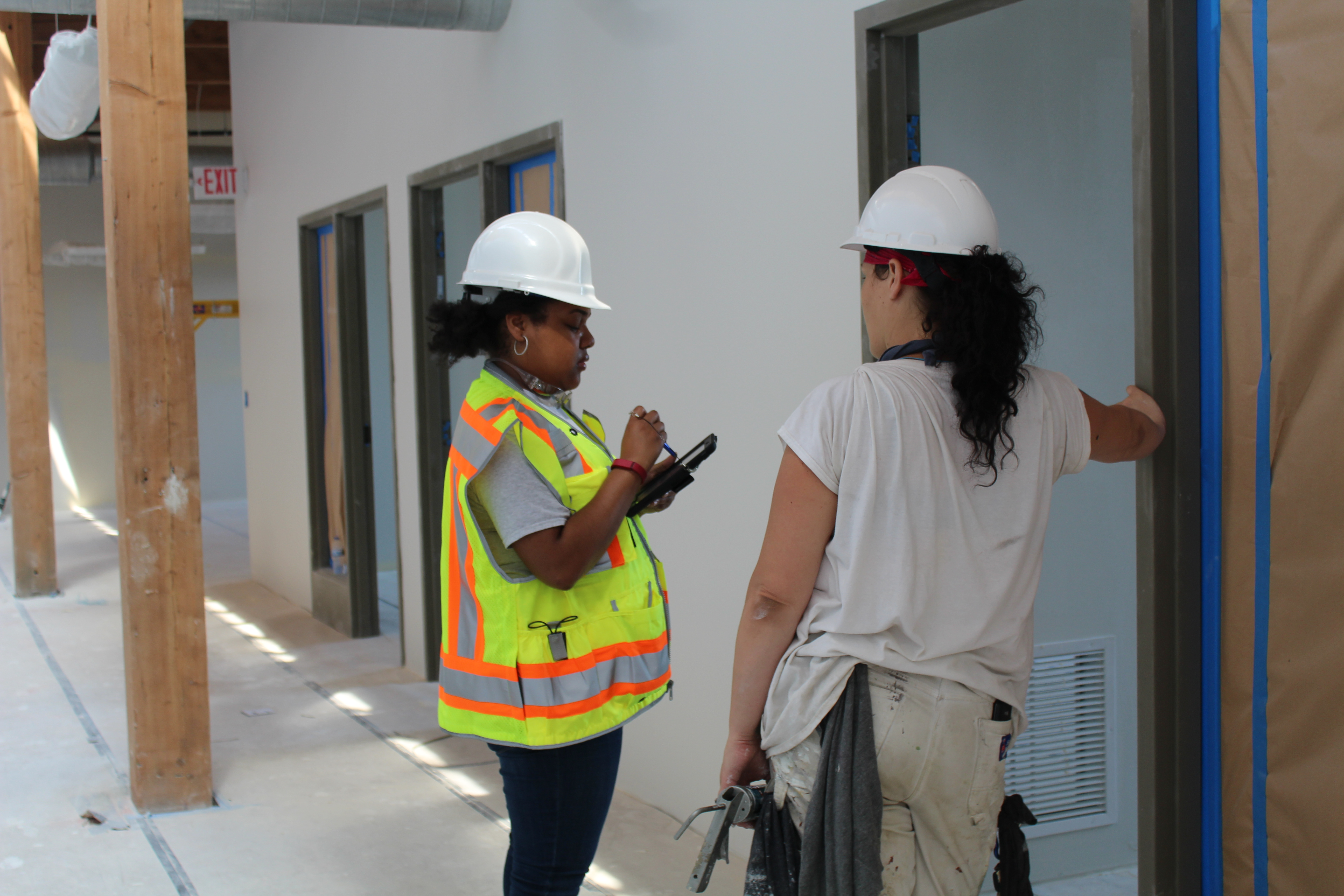 Prism staff engaging with worker.