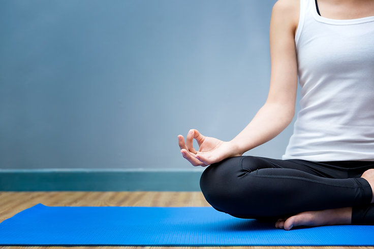 Young woman meditates while practicing y