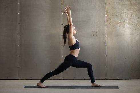 Young attractive woman practicing yoga,