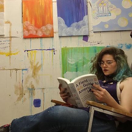 Artist Kenna Lindsay in studio with cloud cities work in progress