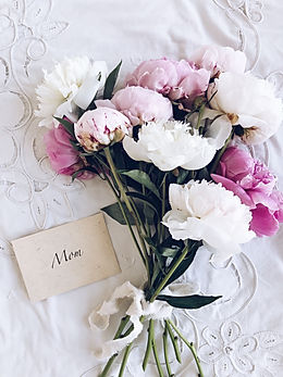 bouquet-of-peonies-next-to-an-envelope-w