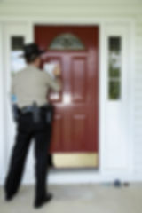 Law enforcement officer posting an evict