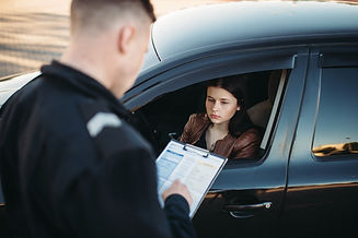 Policeman in uniform writes fine to fema