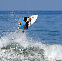 Pedro cruz doing a frontside air in tamarindo costa rica while surfing