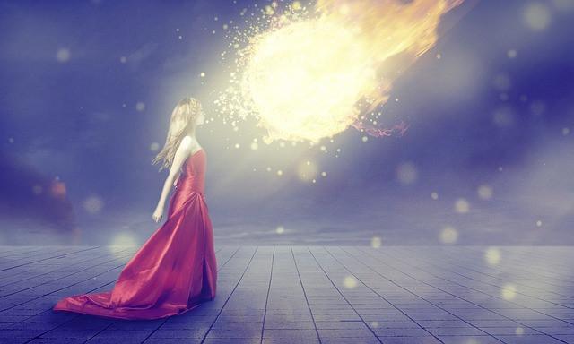 girl facing ball of fire