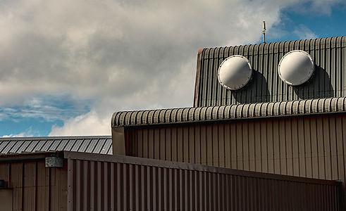 Custom-fabricated-green-metal-roof.jpg