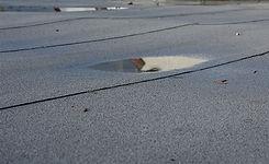Ponding-rainwater-on-flat-roof-after-rai