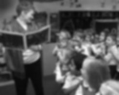 pre-k teacher enthralls her class with a book reading