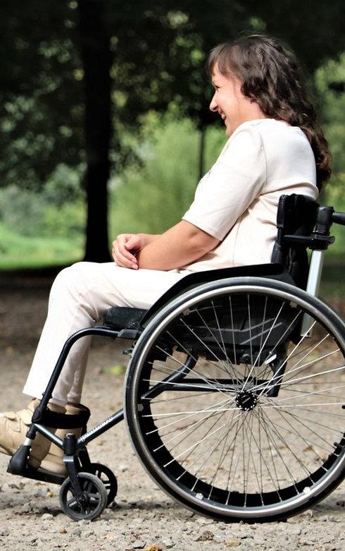 woman-on-black-folding-wheelchair-2026764_edited_edited_edited.jpg