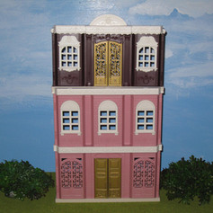 Pink building with brown building on top