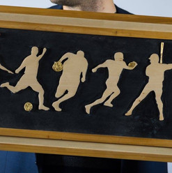 Sillouette Sports Relief Carving with Gilded Gold Accents