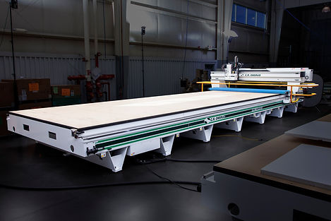A C.R. Onsrud G-Series CNC Router With Long Table and Dark Background