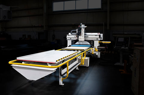 A C. R. Onsrud Roller Hold Down CNC Router With Dark Background