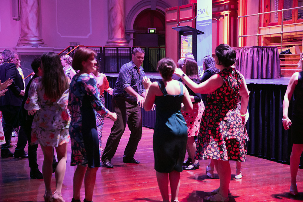 People dancing to music from Adelaide DJ duo Funk Bros DJs at Adelaide Town Hall for ICEN 2019 Conference Dinner
