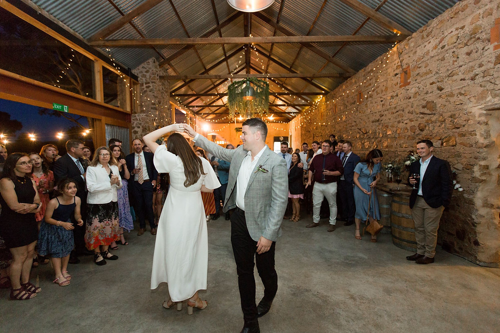 The bridal couple dancing at Erika and Tim's wedding at Barn 1890 to music by Adelaide DJs Funk Bros DJs