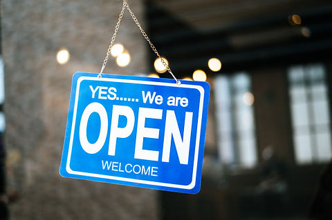 we-are-open-sign-broad-through-glass-win