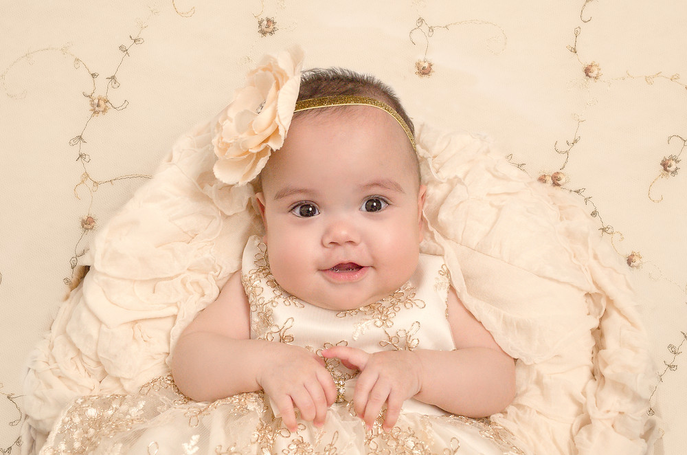 Cute baby girl in gold dress.