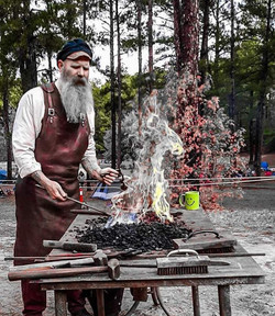 Red forging on coal in his leather shop