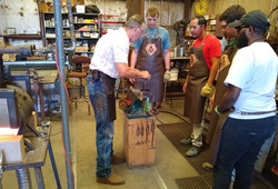 Group of friends learn to blacksmith at