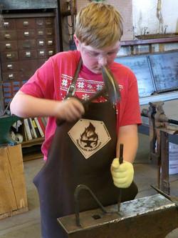 Thomas learns to blacksmith